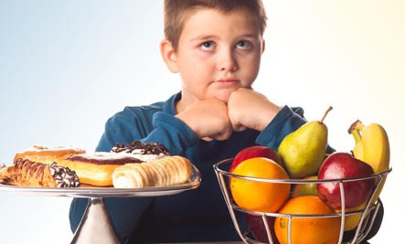boy-choosing-between-junk-and-health-food